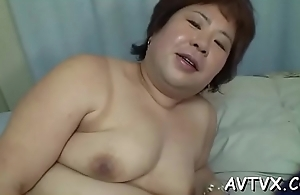 Oriental babe'_s slit is awfully wet from zealous sex toying