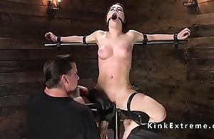 Busty slave in stock vined and caned