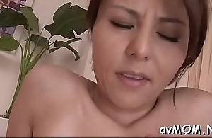 Horny young mama gets fingered and teased with fake penis
